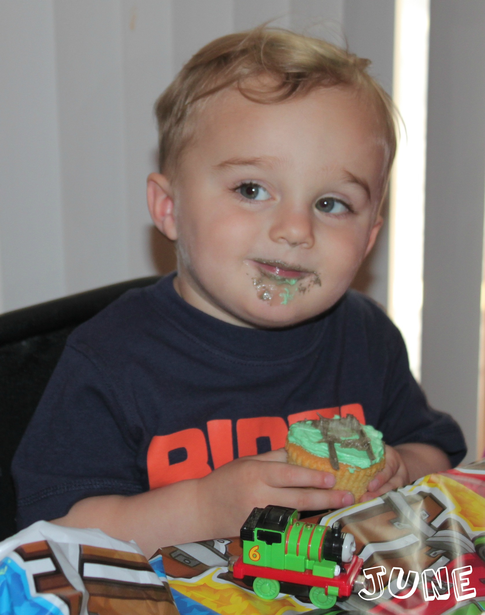toddler eating cupcake