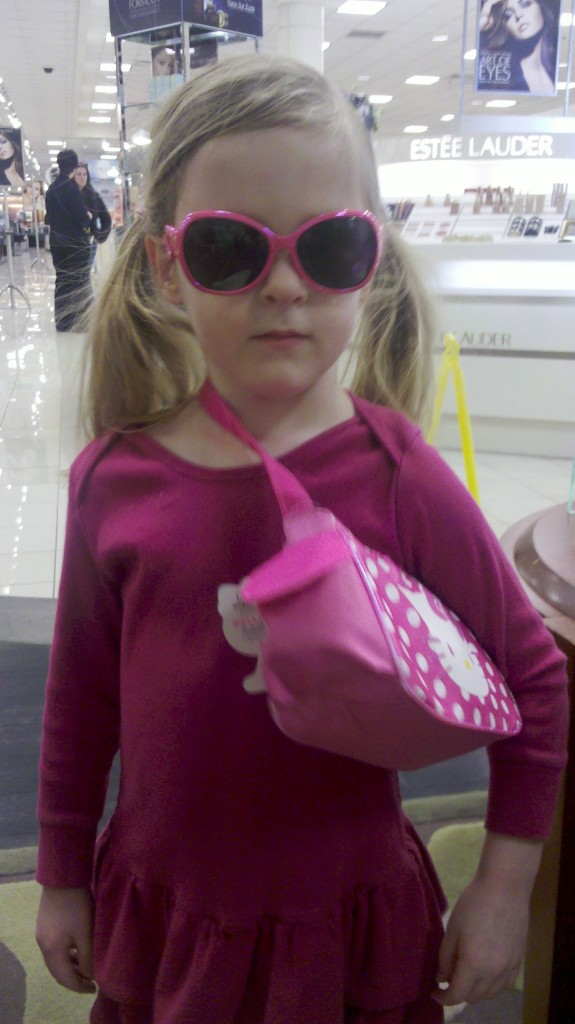 toddler with purse and sunglasses