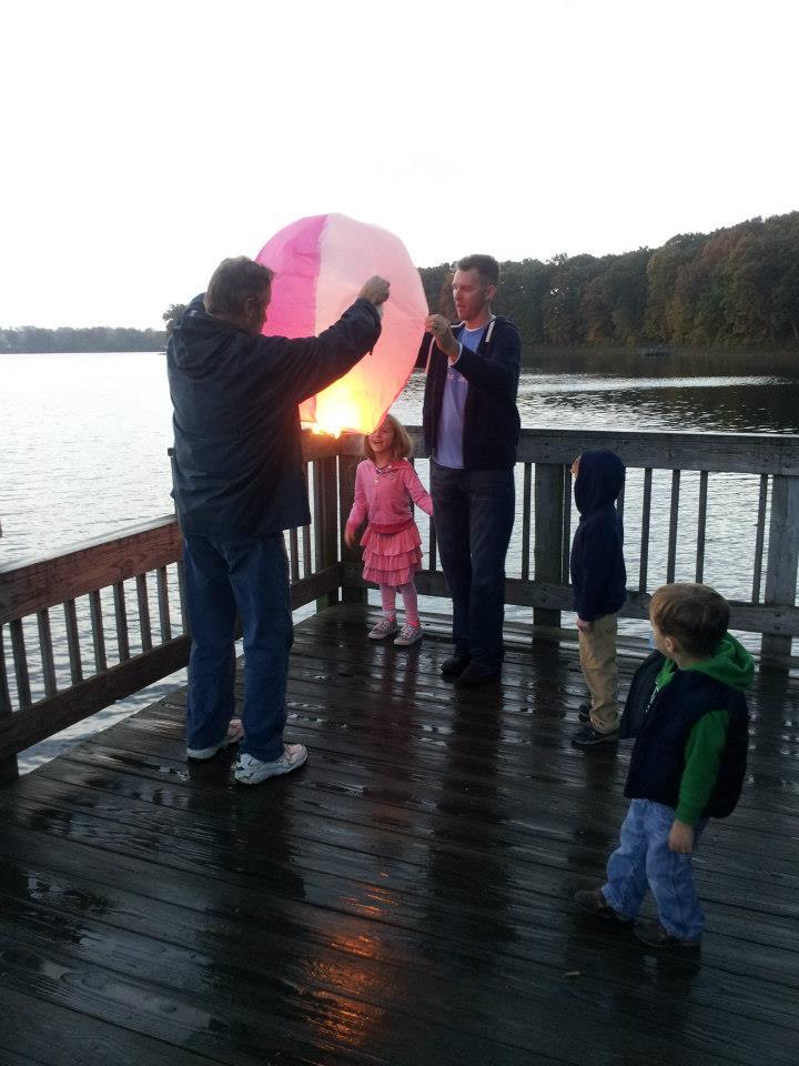holding pink lantern