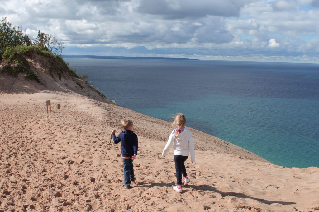 kids walking at dunes