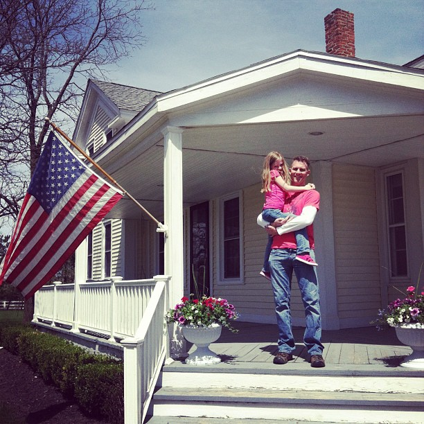 Dad and daughter on porch