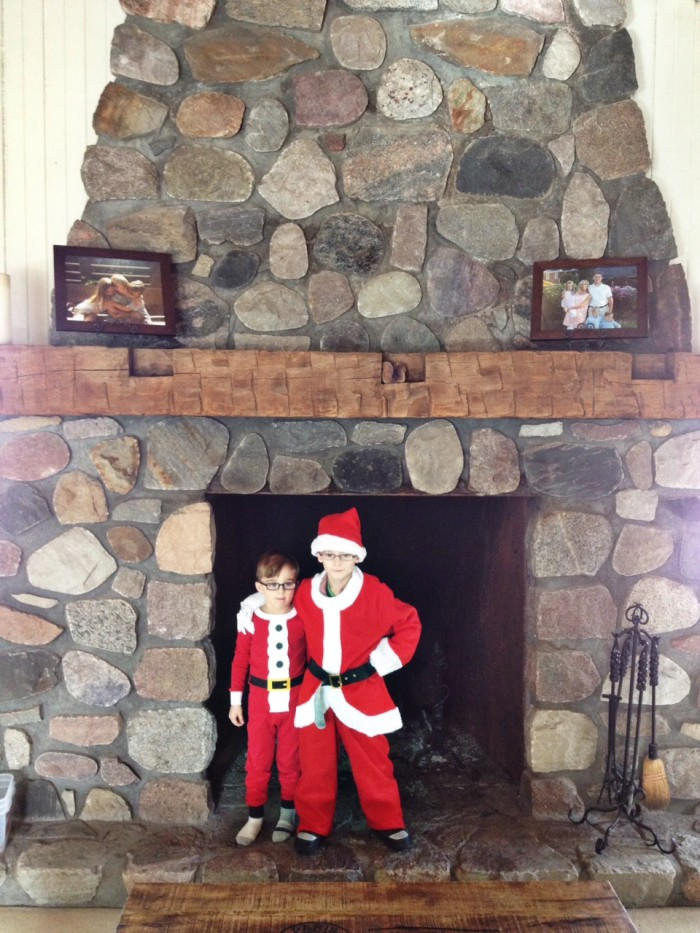 kids dressed as santa